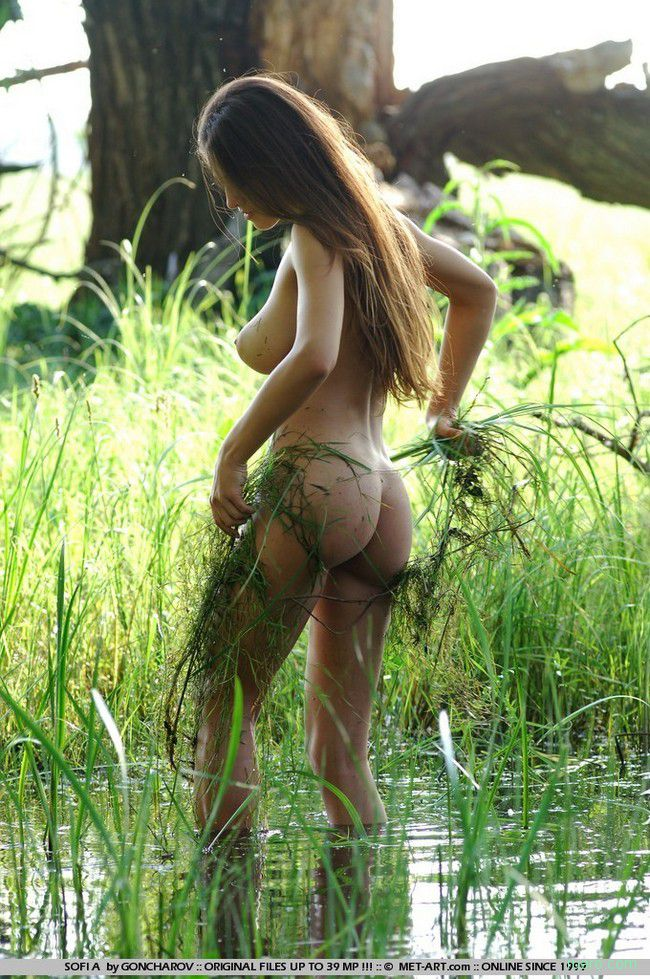 Young Brunette Girl With Fishing Net Reveals In The Swampland Trees 1